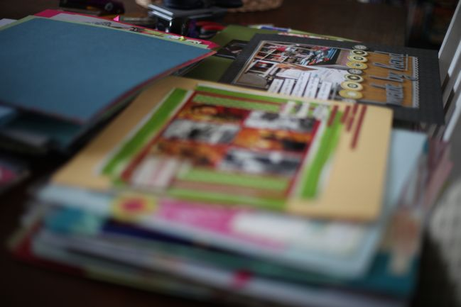 sorting scrapbook pages into albums