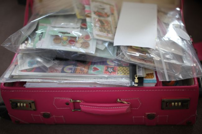 suitcase packed to scrapbook at a friend's house