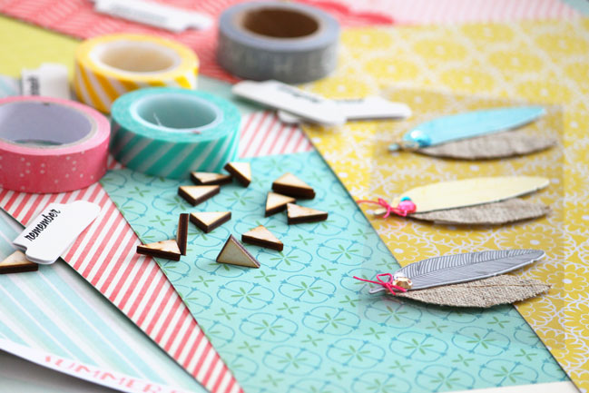 scrapbooking supplies and feather embellishments